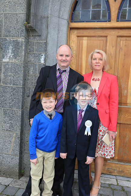 Kevin Heavey, Donnacha Ivan and Meave at first communion in Slane..Picture:  www.newsfile.ie ..