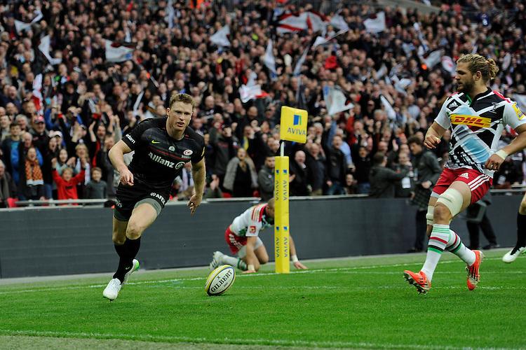 Chris Ashton of Saracens scores a try in the corner
