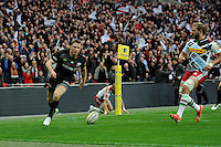 Chris Ashton of Saracens scores a try in the corner