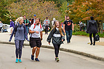 Friends react to having their photo made as they walk to their morning classes. Photo by Robert Jordan/Ole Miss Communications