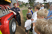 Firefighters on a school visit to local primary school. Children are being taught on what to do in case of fire at home. Given a talk and shown a video before being taken outside to see the fire appliance and play with the hose reel. This image may only be used to portray the subject in a positive manner..©shoutpictures.com..john@shoutpictures.com