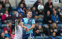 Garry Thompson of Wycombe Wanderers wins the ball in the air during the Sky Bet League 2 match between Wycombe Wanderers and Barnet at Adams Park, High Wycombe, England on 22 October 2016. Photo by Andy Rowland.