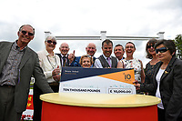 Connections of Simply Breathless receive their cheque for winning The Bathwick Tyres Novice Auction Stakes(plus 10, Div 2), during Afternoon Racing at Salisbury Racecourse on 13th June 2017