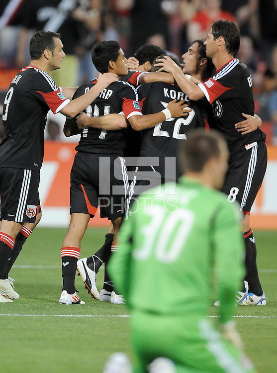 D.C. United forward Dwayne de Rosario (7) celebrates his second goal in the 43th minute of the game with teammates. D.C. United defeated Toronto FC 3-1 at RFK Stadium, Saturday May 19, 2012.