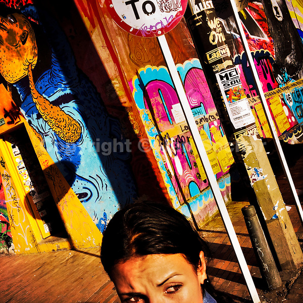 A Colombian girl walks around a street corner, covered in colorful graffiti artwork and posters, in La Candelaria, Bogota, Colombia, 19 February, 2016. A social environment full of violence and inequality (making the street art an authentic form of expression), with a surprisingly liberal approach to the street art from Bogotá authorities, have given a rise to one of the most exciting and unique urban art scenes in the world. While it's technically not illegal to scrawl on Bogotá's walls, artists may take their time and paint in broad daylight, covering the walls of Bogotá not only in territory tags and primitive scrawls but in large, elaborate artworks with strong artistic style and concept. Bogotá has become an open-air gallery of contemporary street art.
