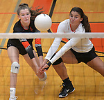 Edwardsville players Kaitlyn Conway (left) and Rhianna Huebner both try to bump an O'Fallon serve at Edwardsville High School on Tuesday October 2, 2018. Tim Vizer/Special to STLhighschoolsports.com