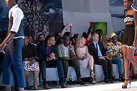 KIGALI, RWANDA NOVEMBER 7: People watch a fashion show the gala night at Kigali Fashion week on November 7, 2014 held at Kigali City Towers in Kigali, Rwanda. Designers and from Rwanda, Burundi and Uganda showed their latest collections at the yearly event. The event was held at a parking lot at a popular shopping mall in Kigali. (Photo by: Per-Anders Pettersson)