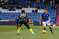 Oldham Athletic's Rob Hunt (right)  vies for possession with  Bristol Rovers' Marc Bola (left) during the Sky Bet League 1 match between Oldham Athletic and Bristol Rovers at Boundary Park, Oldham, England on 30 December 2017. Photo by Juel Miah / PRiME Media Images.