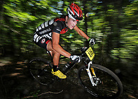 STAFF PHOTO BEN GOFF  @NWABenGoff -- 09/07/14  Austin Morris races in the Category 1 age 19-29 race during Slaughter Pen Jam, part of the Arkansas Mountain Bike Championship Series, on the Slaughter Pen trails in Bentonville on Sunday September 7, 2014. Morris placed second in his age group.