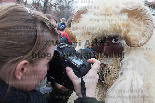 Local people in traditional buso dresses celebrate the Buso Carnival in Mohacs (about 200 km South from capital city Budapest), Hungary on February 07, 2016. ATTILA VOLGYI