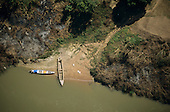 Bacaja village, Brazil. Aerial view of river access with two boats and steps; Xicrin Indian tribe, Amazon.