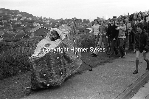 Minehead Hobby Horse, Minehead Somerset, 1975. Young boy in own horse,