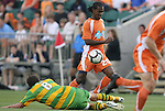 14 May 2010: Tampa Bay's Jeremy Christie (NZL) (8) tackles the ball away from Carolina's Gregory Richardson (GUY) (20). The FC Tampa Bay Rowdies defeated the Carolina RailHawks 2-1 at WakeMed Stadium in Cary, North Carolina in a regular season U.S. Soccer Division-2 soccer game.