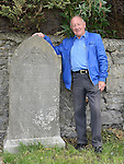 Danny Black pictured at the gravestone of his great grandfather Michael Black from Colpe at the old Chord Cemetery tour organised by the Civic Thrust as part of the Arts Festival. Photo:Colin Bell/pressphotos.ie