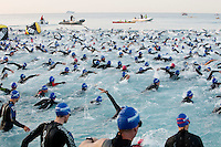 Triathletes swimming in the sea during the first stage of the 2012 Ironman France, Nice, France, 24 June 2012