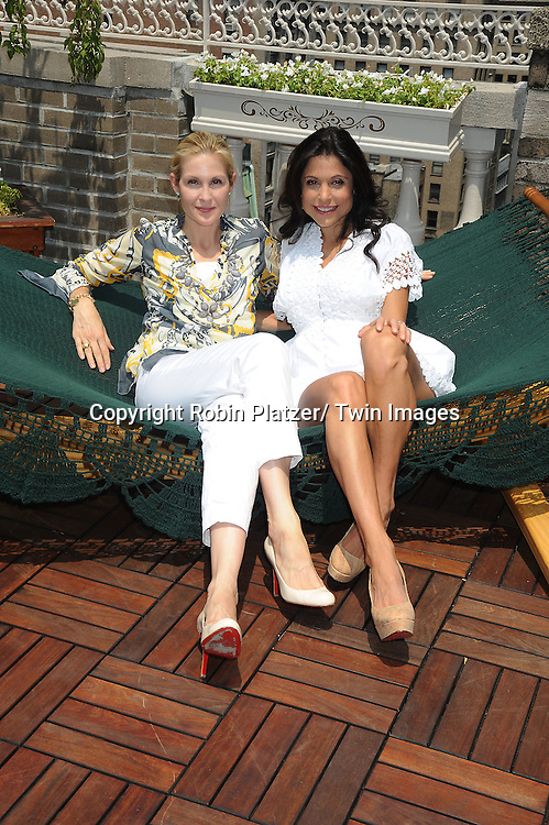 Kelly Rutherford and Bethenny Frankel at the Childhelp and Hayneedle.com event at the Midtown LOft and Terrace in New York City on July 21, 2010.  July 22 is national Hammocks Day.
