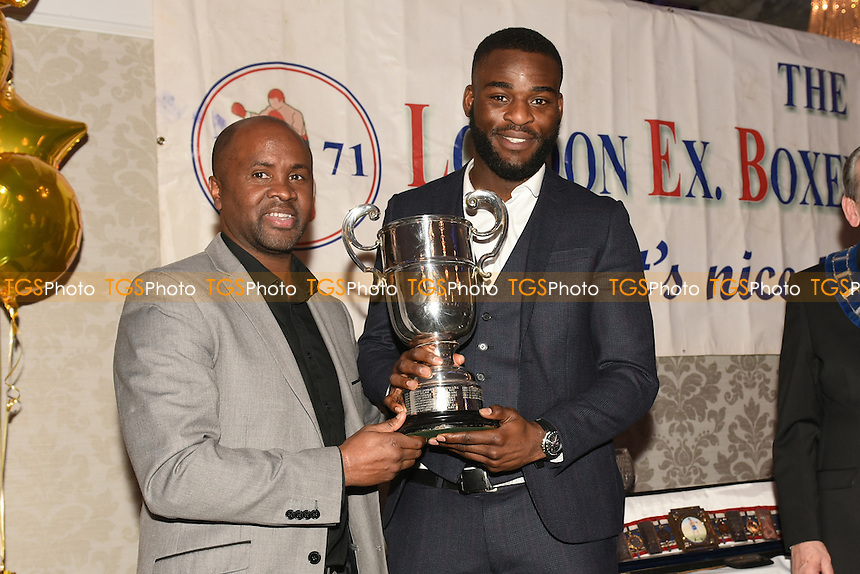 Joshua Buatsi receives the Pat Floyd Cup for Best Amateur Boxer during the London Ex-Boxers Awards at the Grand Connaught Rooms on 19th February 2017