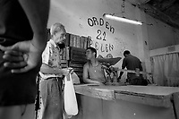Habaneros buy vegetables from an official ration store in Havana, Cuba, August, 2001.  Facing difficulties from the loss of Soviet support, Cuba opened an unofficial dollar economy in the late 1990s.