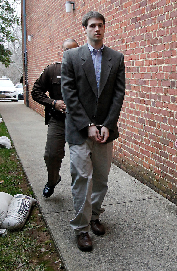 CHARLOTTESVILLE, VA - FEBRUARY 14: George Huguely is escorted to court Tuesday morning as his trial in the death of former girlfriend Yeardley Love continues. Huguely was charged in the May 2010 death of his girlfriend Yeardley Love. She was a member of the Virginia women's lacrosse team. Huguely pleaded not guilty to first-degree murder. (Credit Image: © Andrew Shurtleff/