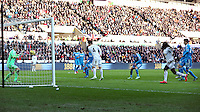 SWANSEA, WALES - FEBRUARY 07: Ki Sung Yueng of Swansea (C) scores a goal only to be disallowed by the referee as an offside during the Premier League match between Swansea City and Sunderland AFC at Liberty Stadium on February 7, 2015 in Swansea, Wales.