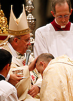 Papa Francesco pone le mani sul capo del nuovo vescovo francese Monsignor Jean-Marie Speich durante una messa di ordinazione episcopale, nella Basilica di San Pietro, Citta' del Vaticano, 24 ottobre 2013.<br /> Pope Francis puts his hands on the head of new bishop Monsignor Jean-Marie Speich, of France, during an episcopal ordination mass in St. Peter's Basilica at the Vatican, 24 October 2013.<br /> UPDATE IMAGES PRESS/Riccardo De Luca<br /> <br /> STRICTLY ONLY FOR EDITORIAL USE