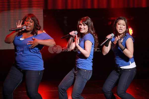 Amber Riley, Lea Michele and Jenna Ushkowitz performing at the Glee Concert Tour. The Gibson Amphitheatre at Universal City Walk in Los Angeles, California. May 20, 2010.Credit: Dennis Van Tine/MediaPunch