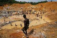Gold mining on river banks outside of Prestea where AngloGold is hte world's most valuable mining company.  They will not let these artisanals mine their tailing piles.  They brough in the military to run them off but when the military leaves, the artisanals will return.