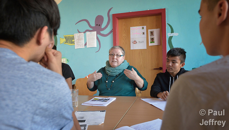 Helene Bindl teaches German to young Afghan asylum seekers at the Zentrum Spattstrasse, a shelter in Linz, Austria, owned by the United Methodist Church and part of Diakonie, an ecumenical network that is a member of the ACT Alliance. Bindl is a member of the United Methodist Church in Linz.
