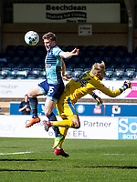 Dayle Southwell of Wycombe Wanderers and Goalkeeper Rob Lainton of Cheltenham Town (on loan from Bury) during the Sky Bet League 2 match between Wycombe Wanderers and Cheltenham Town at Adams Park, High Wycombe, England on the 8th April 2017. Photo by Liam McAvoy.