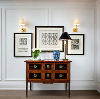 Thoughtfully chosen prints, a slender lamp and carefully placed objects on a Georgian console table make an elegant arrangement in the hallway.
