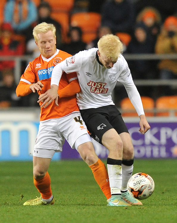 Blackpool's David Perkins battles with Derby County's Will Hughes<br /> <br /> Photographer Dave Howarth/CameraSport<br /> <br /> Football - The Football League Sky Bet Championship - Blackpool v Derby County - Tuesday 21st October 2014 - Bloomfield Road - Blackpool<br /> <br /> &copy; CameraSport - 43 Linden Ave. Countesthorpe. Leicester. England. LE8 5PG - Tel: +44 (0) 116 277 4147 - admin@camerasport.com - www.camerasport.com
