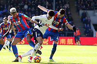 Dele Alli of Tottenham Hotspur and Luka Milivojevic  and Patrick van Aanholt of Crystal Palace during Crystal Palace vs Tottenham Hotspur, Premier League Football at Selhurst Park on 25th February 2018
