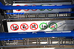 Close up of line of stacked luggage trolleys with rules about use, Malaga airport, Spain