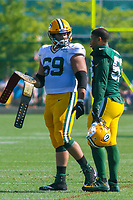 Green Bay Packers linebacker Nick Perry (53) and tackle David Bakhtiari (69) during a training camp practice on August 1, 2017 at Ray Nitschke Field in Green Bay, Wisconsin.  (Brad Krause/Krause Sports Photography)