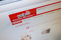 The Yelp home page, the online crowdsourcing review site, is seen on Friday, March 2, 2012 in New York on the day of Yelp's initial public offering. The eight year old, still unprofitable company priced its IPO at $15 per share. Beside restaurants, Yelp carries reviews by viewers of a multitude of businesses and services. (© Richard B. Levine)