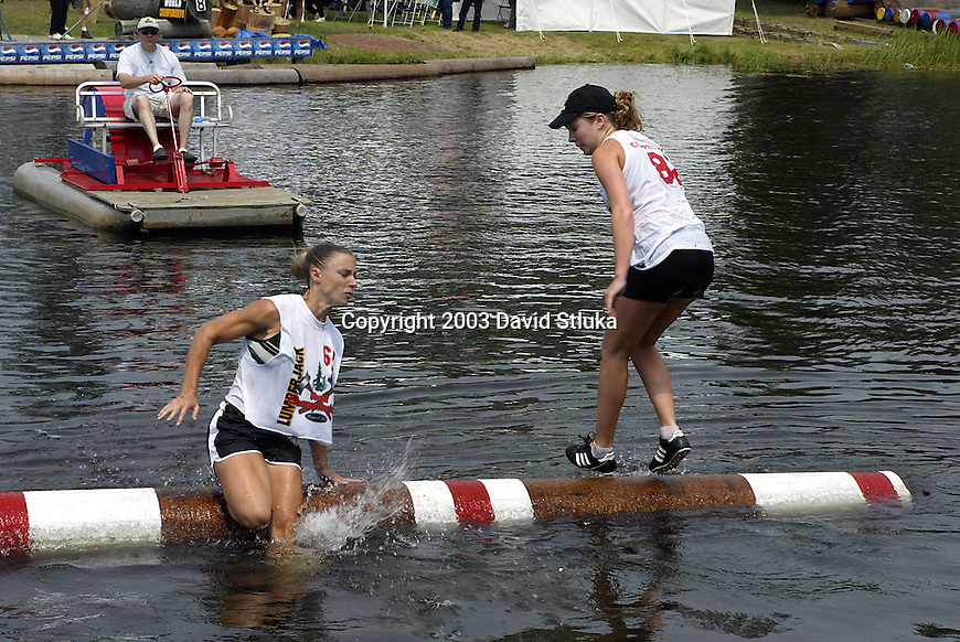 7/25/03 -Hayward, Wisconsin. Log rolling competition at the Lumberjack World Championships on Friday. Shana Martin (62) vs. Carly Scheer (82). (Photo by David Stluka)