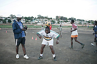 """SOWETO, SOUTH AFRICA - OCTOBER 23: Zacharia """"Computer"""" Lamula, an old football star in the local team Kaizer Chiefs teaches young boys his skills on September 15, 2007 in the Motswaledi section of Soweto, South Africa. Soccer is the most popular sport in South Africa, and a because of the upcoming World Cup 2010, the interest is increasing. For the first time the World Cup will be held on the African continent. South Africa doesn't have an organized youth soccer program and many teams and players struggle with lack of funds to buy equipment and securing money for transport to games. (Photo by Per-Anders Pettersson)...."""
