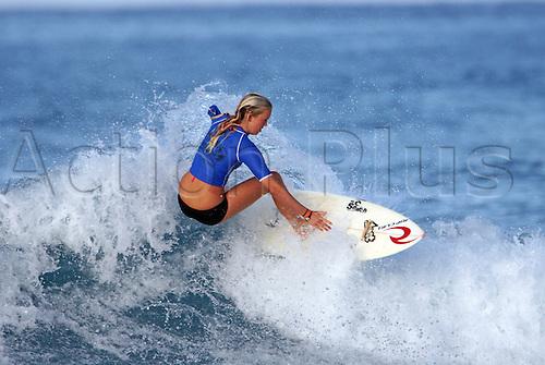 January 13, 2007: Bethany Hamilton surfs during an NSSA surf contest in Kona, Hawaii.