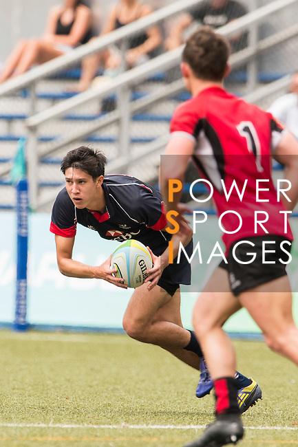 Daniel Archer (l) of Hong Kong in action during the match between Hong Kong and Singapore of the Asia Rugby U20 Sevens Series 2016 on 12 August 2016 at the King's Park, in Hong Kong, China. Photo by Marcio Machado / Power Sport Images