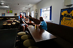 Two groundhoppers from Colchester watching England's women play New Zealand in the club bar. Yorkshire v Parishes of Jersey, CONIFA Heritage Cup, Ingfield Stadium, Ossett. Yorkshire's first competitive game. The Yorkshire International Football Association was formed in 2017 and accepted by CONIFA in 2018. Their first competative fixture saw them host Parishes of Jersey in the Heritage Cup at Ingfield stadium in Ossett. Yorkshire won 1-0 with a 93 minute goal in front of 521 people. Photo by Paul Thompson