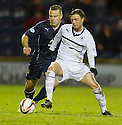Raith Rovers' Joe Cardle holds off Dundee's Gavin Rae.