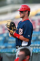 Washington Nationals minor league outfielder Bryce Harper (34) in the dugout during a game vs. the Chinese National Team in an Instructional League game at Holman Stadium in Vero Beach, Florida September 30, 2010.   Harper was selected in the first round, 1st overall, of the 2010 MLB Draft out of Southern Nevada Junior College.  Photo By Mike Janes/Four Seam Images