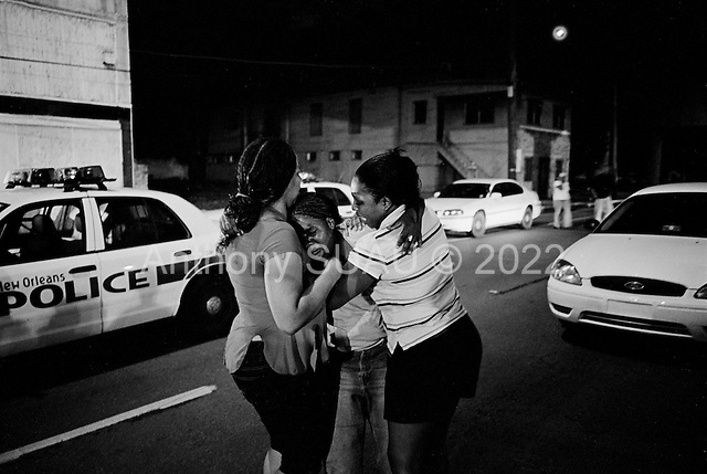New Orleans, Louisiana.USA.July 28, 2006..A quadruple homicide in the city center on a Friday night. Crime is on the rise as residents return looking for work and living in questionable housing conditions. Younger drug lords try to claim territory in the new destroyed New Orleans nearly one year after hurricane Katrina hit and the levees broke leaving 80% of the city flooded. ...Juanita Thomas, an aunt of three of the slain victims, cries at the scene of the murders.