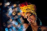 A Cuban girl performs a provocative salsa dance during the Carnival in Santiago de Cuba, Cuba, 26 July 2008. Carnival in Santiago de Cuba is a large public celebration which is held - contrary to the other Latin American carnivals - in the summer. The carnival tradition dates back to the 17th century when the Spanish festival of Santiago (St. James) was mixed with street dancing parades of the Black African slaves. Nowadays comparsas, carnival groups of dancers and musicians, flow in the streets and perform popular music like salsa, rumba or reggaeton. In spite of the general lack of funds in Cuba (most of the festival costumes and floats are home-made) the Carnival is very lively and hot show with huge participation of the people of Santiago de Cuba.