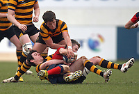 4 March 2013; Ballyclare winger James Greer is tackled by RBAI centre Rory Bell during the schools cup semi-final clash between RBAI and Ballyclare High School at Ravenhill Belfast. Photo Credit : John Dickson / DICKSONDIGITAL