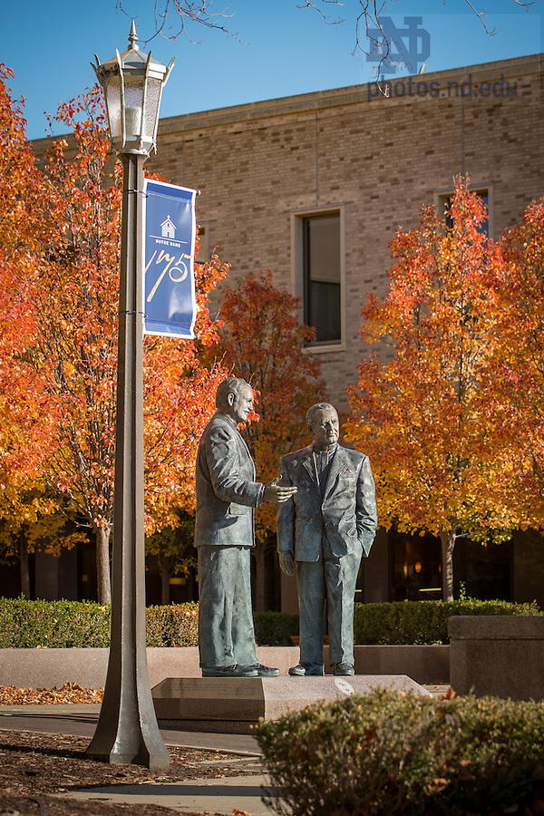 November 30, 2016; Statues of Rev. Edmund Joyce, C.S.C. and Rev. Theodore Hesburgh, C.S.C. outside Hesburgh Library. (Photo by Matt Cashore/University of Notre Dame)