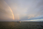 Double Rainbow and boat over the water