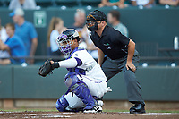 Winston-Salem Dash catcher Yermin Mercedes (6) frames a pitch as home plate umpire Isaias Barba looks on during the game against the Frederick Keys at BB&T Ballpark on July 26, 2018 in Winston-Salem, North Carolina. The Keys defeated the Dash 6-1. (Brian Westerholt/Four Seam Images)