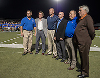 NWA Democrat-Gazette/ANTHONY REYES &bull; @NWATONYR<br /> Rogers Mountaineer Athletic Hall of Fame inductees, from left, Charlie Fredrick, Billy Joe Jones, David Bevis, Scott Pillstrom, Jim White and Kermit Womack, are introduced during halftime Friday, Sept. 11, 2015 at the Rogers versus Claremore, Okla., game at Whitey Smith Stadium in Rogers.