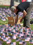 U.S. Air Force veteran Joseph Walker and other Western Nevada College Veterans Resource Center volunteers plant nearly 8,000 American flags at the campus, in Carson City, Nev., on Friday, May 1, 2015. The group will hold a Veterans Suicide Walk Saturday, May 2 at starting 10 a.m. at Bully's Sports Bar and Grill to help raise awareness of the 8,030 veteran suicides each year. <br /> Photo by Cathleen Allison/Nevada Photo Source